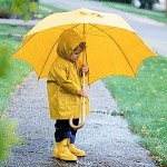 Mandatory Credit: Photo By PHOEBE DUNN / REX FEATURES MODEL RELEASED - A YOUNG CHILD WEARING A YELLOW RAIN COAT HOLDING AN UMBRELLA STOCK UK ONLY CHILD RAINING WEATHER PROTECTIVE CLOTHING WET DRY PROTECTION
